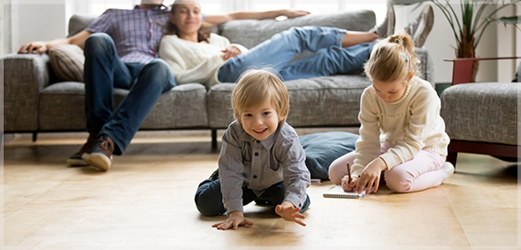 Family relaxing and playing in a living room